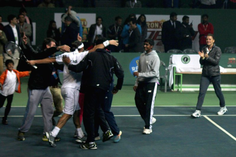 Pune player Marcos Baghdatis celebrates after winning the  Champions Tennis League (CTL) final match against Kevin Anderson of Delhi on Nov 26, 2014. Marcos Baghdatis won.