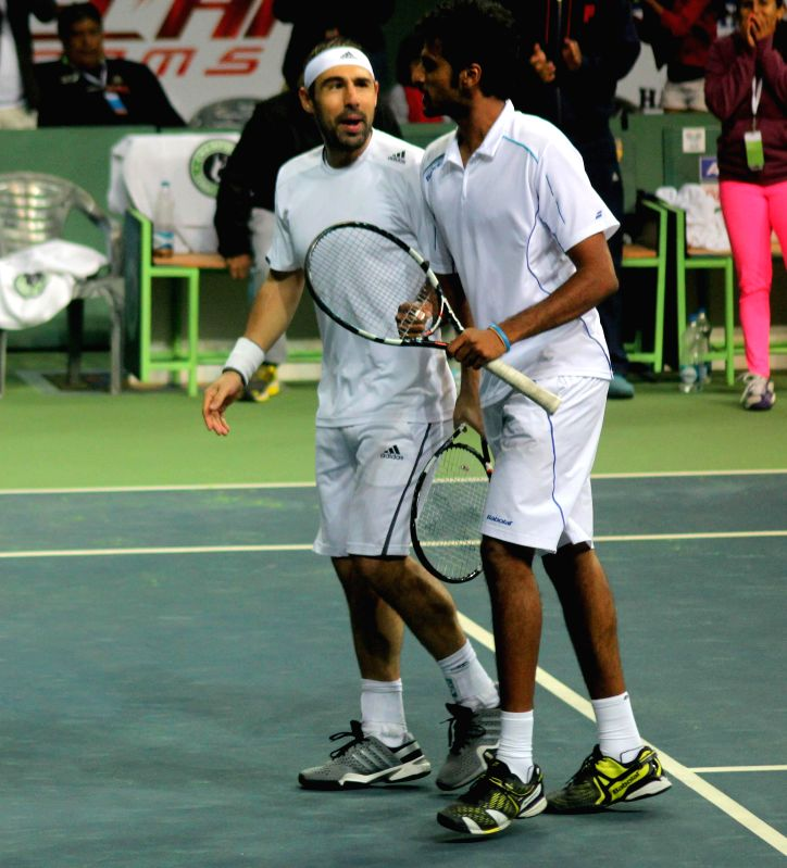 Pune players Marcos Baghdatis and Saketh Myneni during Champions Tennis League (CTL) final match (men's doubles) against Kevin Anderson and Sanam Singh of Delhi at R.K. Khanna Tennis ... - Sanam Singh