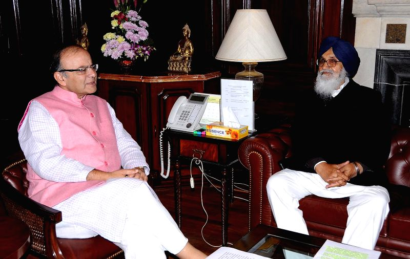 Punjab Chief Minister Parkash Singh Badal calls on Union Finance Minister Arun Jaitley in New Delhi on Feb 13, 2015. - Parkash Singh Badal