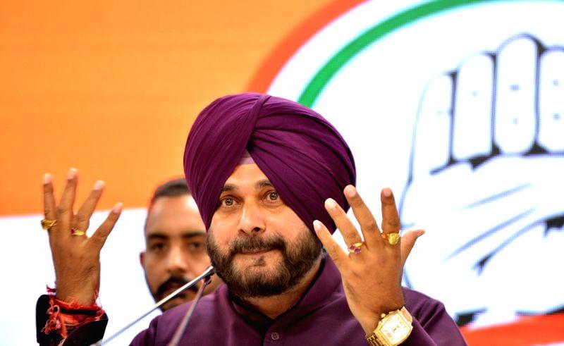 New Delhi: Punjab Minister and Congress leader Navjot Singh Sidhu addresses a press conference in New Delhi, on April 20, 2019.