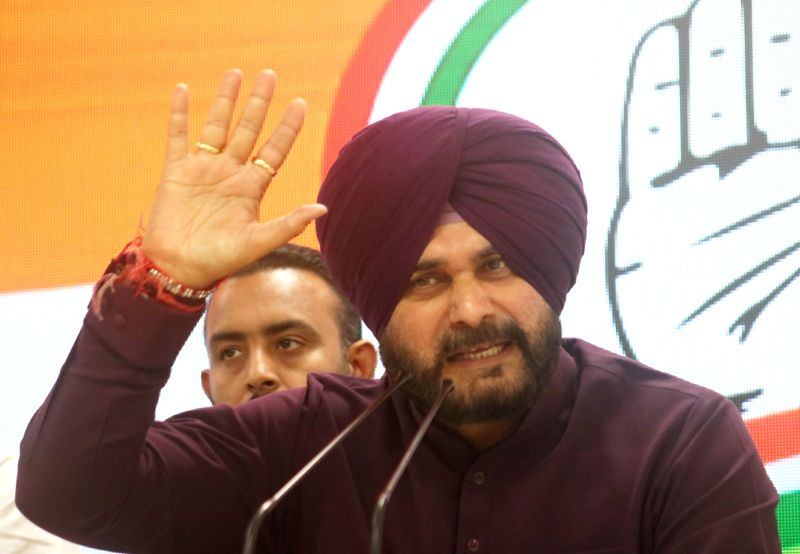 New Delhi: Punjab Minister and Congress leader Navjot Singh Sidhu addresses a press conference in New Delhi, on April 20, 2019.