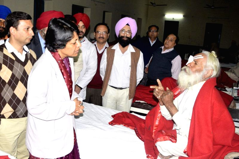 Punjab Principal Secretary Health and Finance Vini Mahajan visits people who lost their vision after undergoing eye surgery at an eye camp organised by an NGO in Gurdaspur district of ... - Vini Mahajan