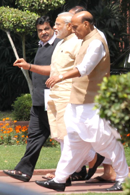 Railway Minister Suresh Prabhu, Defence Minister Manohar Parrikar and Transport Minister Nitin Gadkari after the Union Cabinet  meeting at Parliament House on May 05,2015.(Amlan ... - Suresh Prabhu