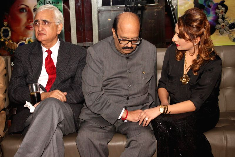 Rajya Sabha member Amar Singh and Congress leader Salman Khurshid during the launch of jewellery designer Chitwan Malhotra`s collection in New Delhi on Dec 9, 2014.