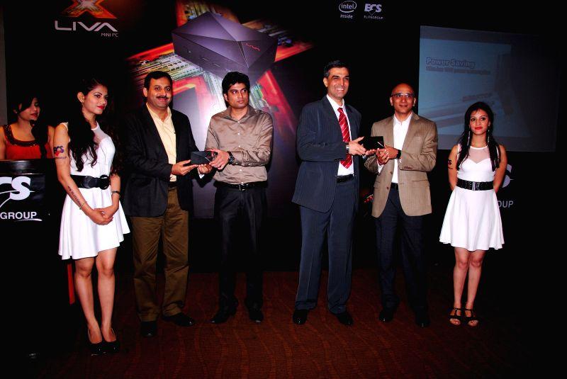 Rashi Peripherals VP Marketing & Sales Rajesh Goenka, Flipkart Assistant Manager Amit Khanna and ECS India Country Manager Rajshekhar Bhatt at the launch of `LIVA Mini PC` in New ... - Rajesh Goenka