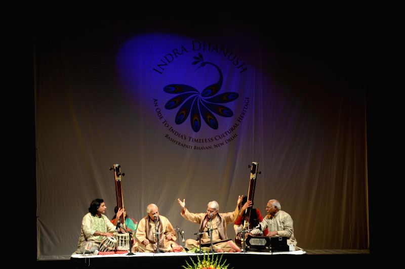 Renowned Indian classical vocalists Pandit Rajan and Sajan Mishra perform during a programme at Rashtrapati Bhavan Auditorium in New Delhi, on Dec 12, 2014.
