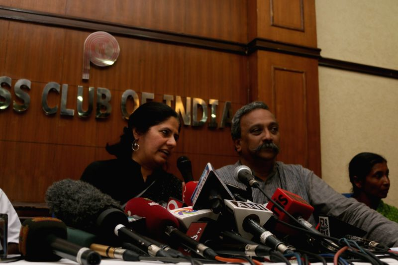 Rights activist Henri Tiphagne and Legal and human rights activist Vrinda Grover during a press conference regarding encounter of 20 alleged red sanders smugglers  in New Delhi, on April ...
