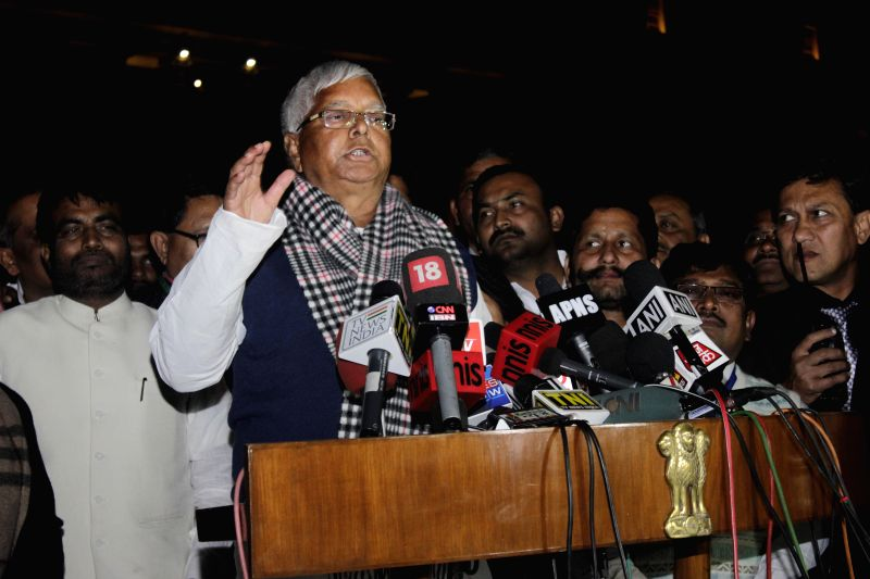 RJD leader Lalu Prasad Yadav addresses press after meeting President Pranab Mukherjee at Rashtrapati Bhawan in New Delhi, on Feb 11, 2015. - Lalu Prasad Yadav and Pranab Mukherjee