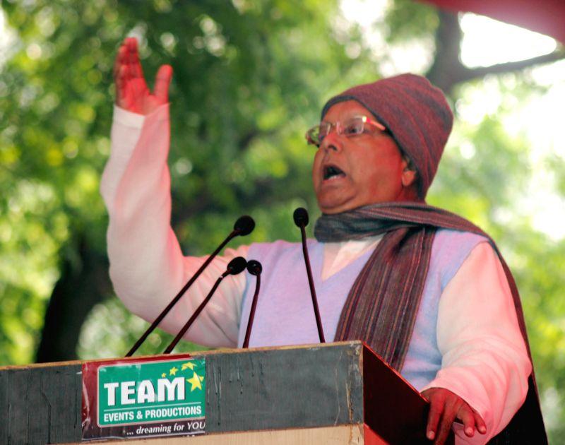 RJD supremo Lalu Prasad Yadav addresses during a programme organised at Jantar Mantar in New Delhi, on Dec 22, 2014. - Lalu Prasad Yadav