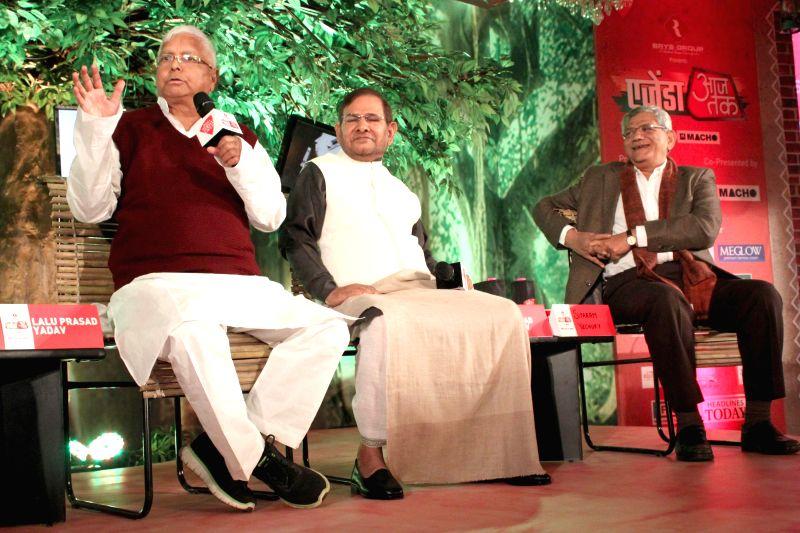 RJD supremo Lalu Prasad Yadav, JD(U) chief Sharad Yadav and CPI(M) leader Sitaram Yechury during a programme organised by Aaj Tak in New Delhi, on Dec 12, 2014.