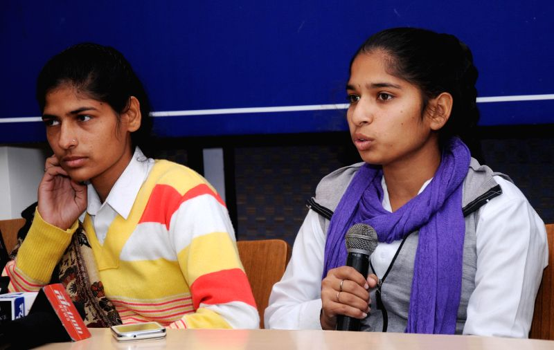 Rohtak sisters - Aarti and Pooja who fought back their harassers in a public transport address a press conference in New Delhi on Dec. 13, 2014.
