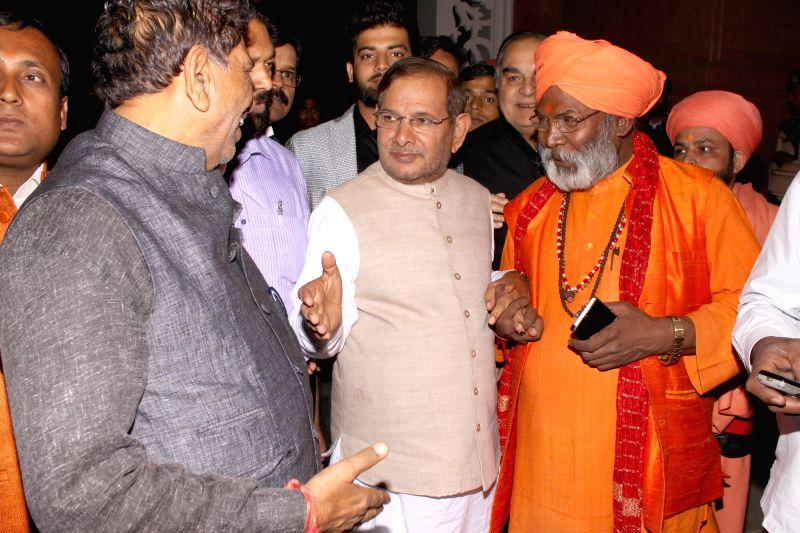 Sakshi Maharaj and Sharad Yadav during the  Wedding ceremony of Rashtriya Janata Dal chief Lalu Yadav's daughter Raj Lakshmi with Samajwadi Party supremo Mulayam Singh Yadav's grandnephew ... - Sharad Yadav, Mulayam Singh Yadav and Tej Pratap Yadav