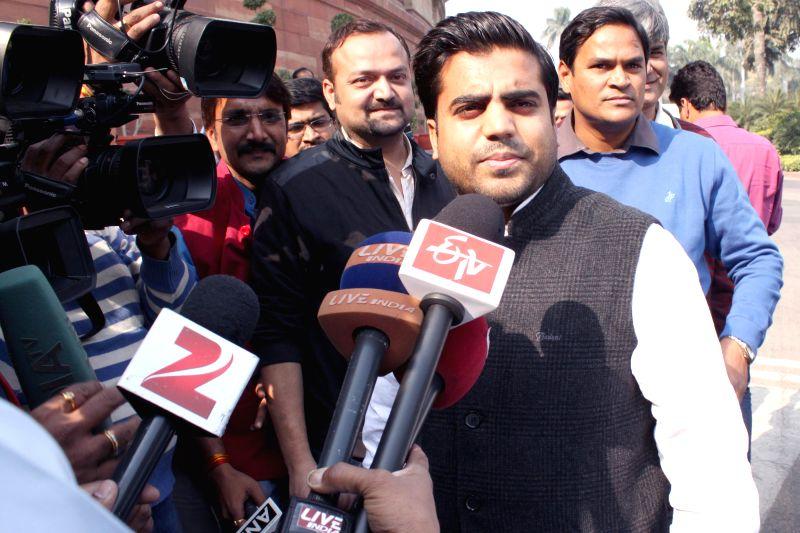 Samajwadi Party MP from Mainpuri Tej Pratap Yadav also the grandnephew of SP supremo Mulayam Singh Yadav at the Parliament premises in New Delhi, on Nov 28, 2014. - Mulayam Singh Yadav