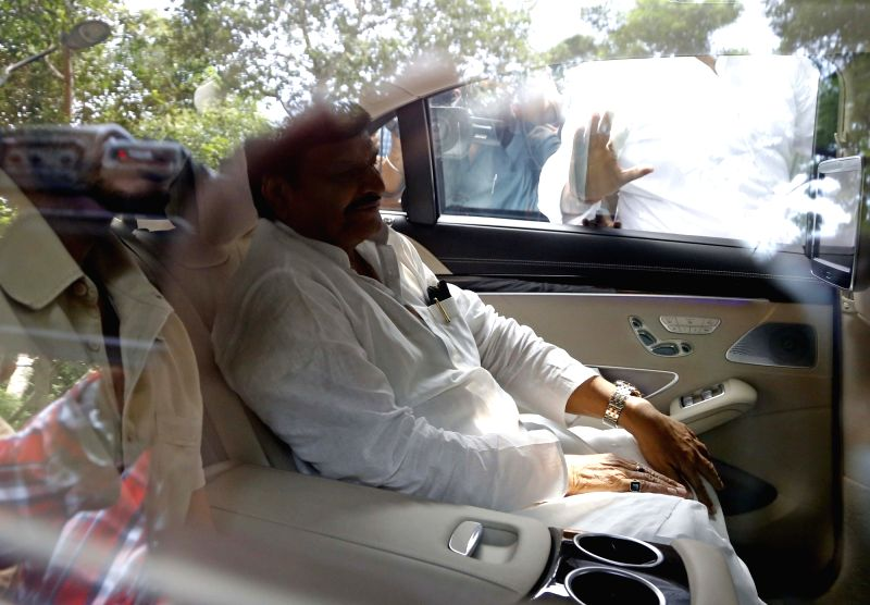 New Delhi: Samajwadi Party party leader Shivpal Yadav and his son Aditya Yadav arrive to meet party chief Mulayam Singh Yadav in New Delhi, on Sept 14, 2016. The development took place after Uttar Pradesh Chief Minister Akhilesh Yadav was removed as