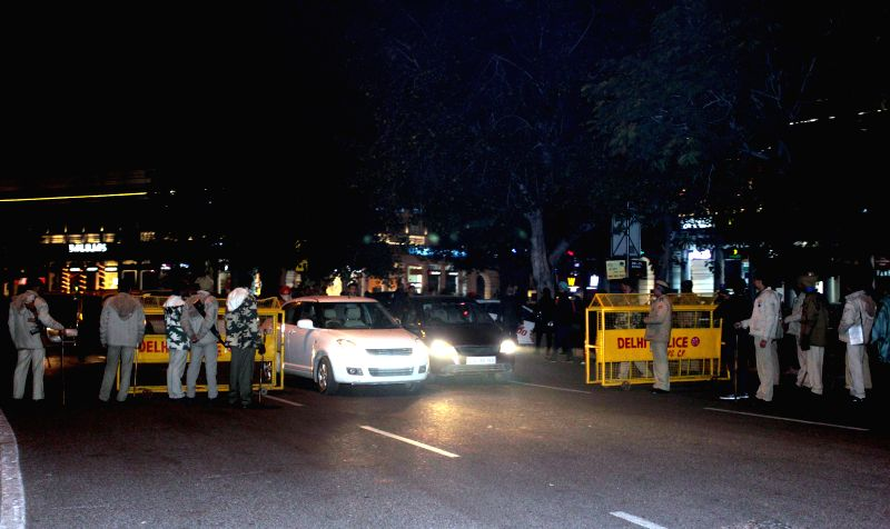 Security beefed-up at Connaught Place on New Year's eve in New Delhi, on Dec 31, 2014.