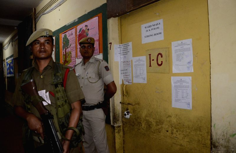 New Delhi: Security personnel in large numbers deployed outside a strong room where EVMs are stored after MCD polls in New Delhi on April 24, 2017.