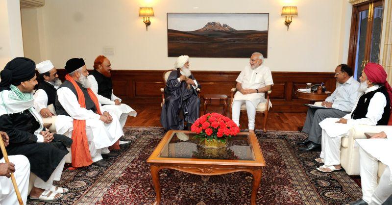 Senior leaders of Muslim Community call on the Prime Minister Narendra Modi, in New Delhi on April 6, 2015. - Narendra Modi