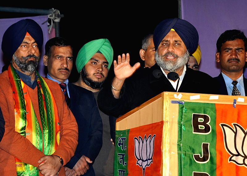 Shiromani Akali Dal President Sukhbir Singh Badal campaigns in favor of Harmeet Singh Kalka, SAD-BJP candidate from Kalkaji assembly constituency, at Gobindpuri in Kalkaji, in New Delhi on