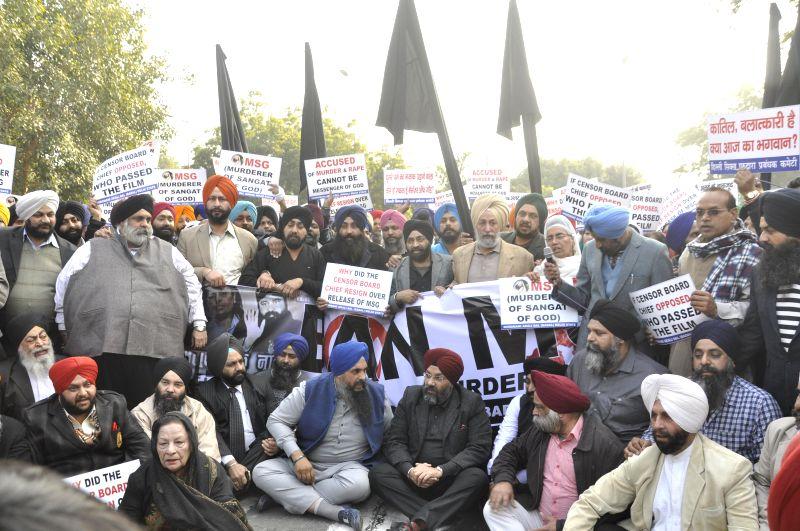 Shiromani Akali Dal workers stage a demonstration against Dera Saccha Sauda chief Gurmeet Ram Rahim Singh starrer film  `MSG - The Messenger of God` in New Delhi, on Jan 16, 2015.