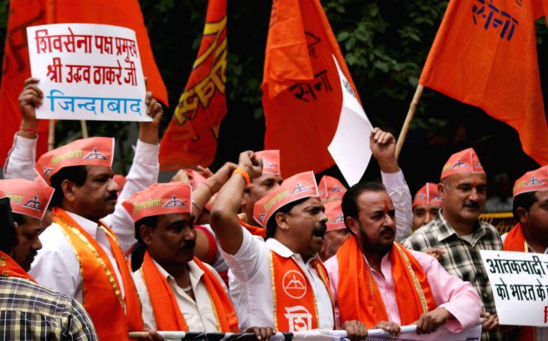 Shiv Sena workers stage a demonstration against Pakistan Prime Minister Nawaz Sharif and Zakiur Rehman Lakhvi at Jantar Mantar in New Delhi, on March 14, 2015. - Zakiur Rehman Lakhvi