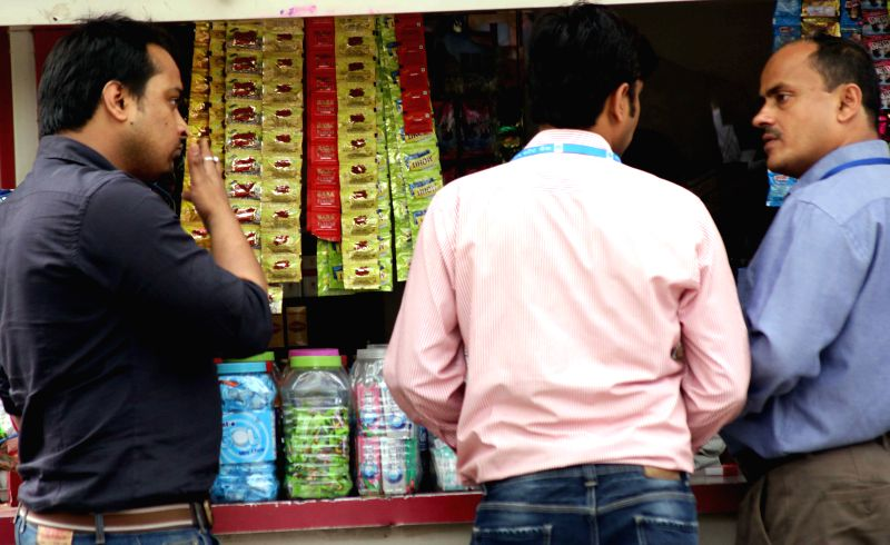 Shops continue to sell chewable tobacco in New Delhi defying Delhi government's ban on their sale, purchase and storage that comes into effect today, on March 30, 2015.