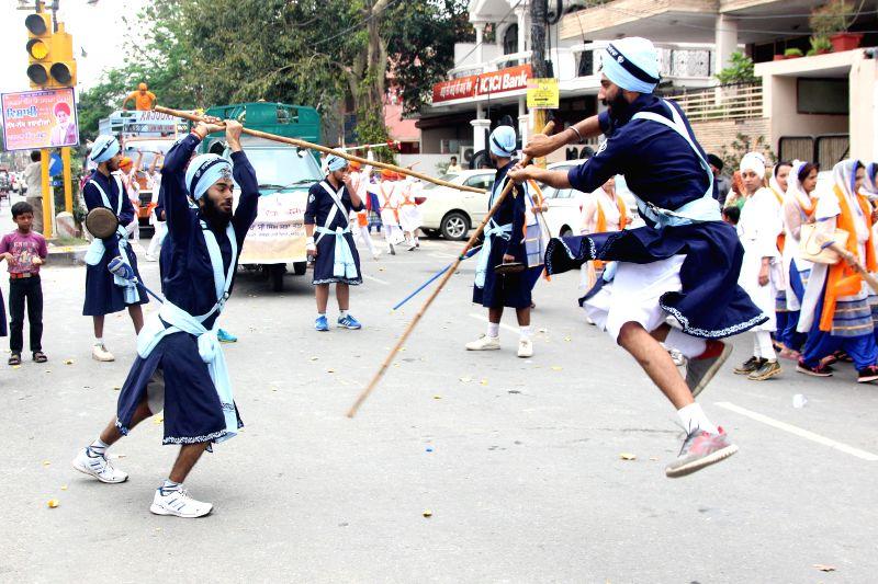 Sikh Nihangs demonstrate their `gatka skills` during Sikh Sajna Divas celebrations in New Delhi, on April 12, 2015.