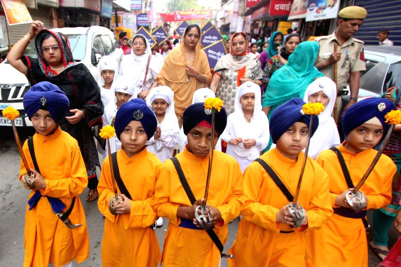 Sikhs participate in a procession organised on Sikh Sajna Divas celebrations in New Delhi, on April 12, 2015.