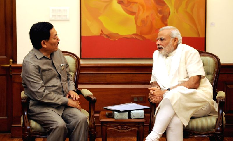 Sikkim Chief Minister Pawan Kumar Chamling calls on the Prime Minister Narendra Modi, in New Delhi on April 6, 2015. - Pawan Kumar Chamling and Narendra Modi