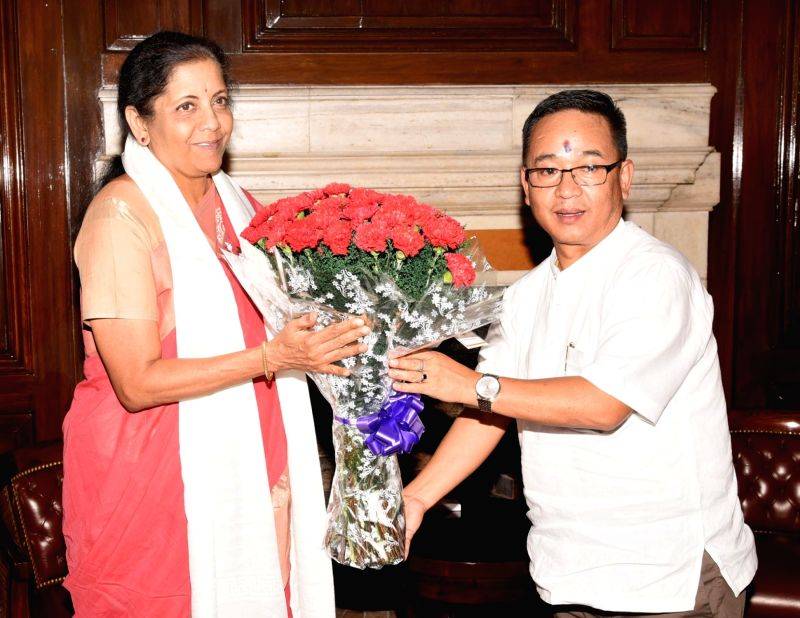 New Delhi: Sikkim Chief Minister Prem Singh Tamang calls on Union Finance and Corporate Affairs Minister Nirmala Sitharaman, in New Delhi on June 12, 2019. (Photo: IANS/PIB)