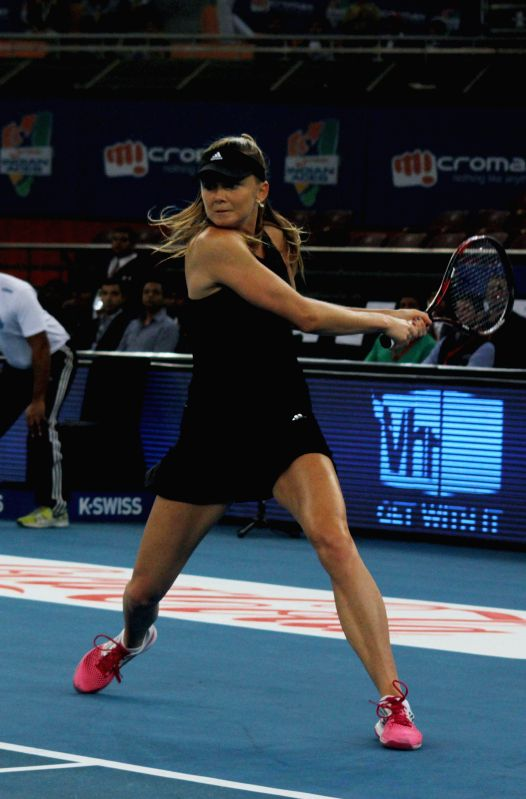 Singapore Slammers Daniela Hantuchova in action during her women's singles match against UAE Royals Caroline Wozniacki on the Coca-Cola International Premier Tennis League (IPTL) at IG ..