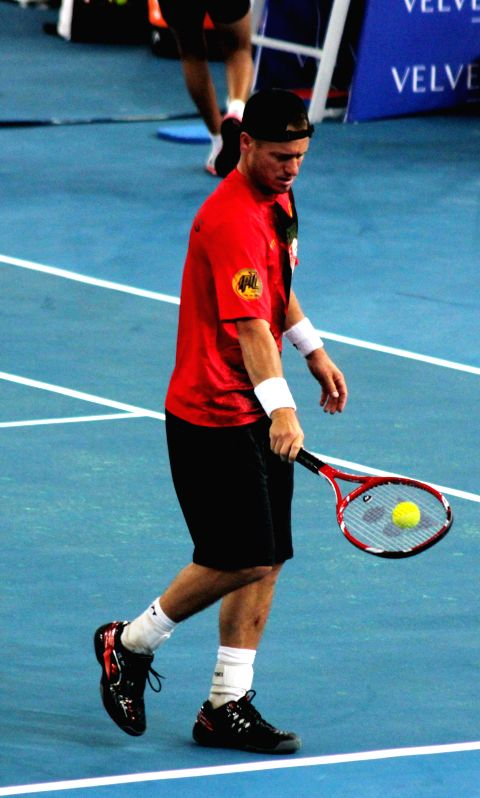 Singapore Slammers Lleyton Hewitt in action during his singles match against UAE Royals Marin Cilic on the Coca-Cola International Premier Tennis League (IPTL) at IG Indoor Stadium in New .