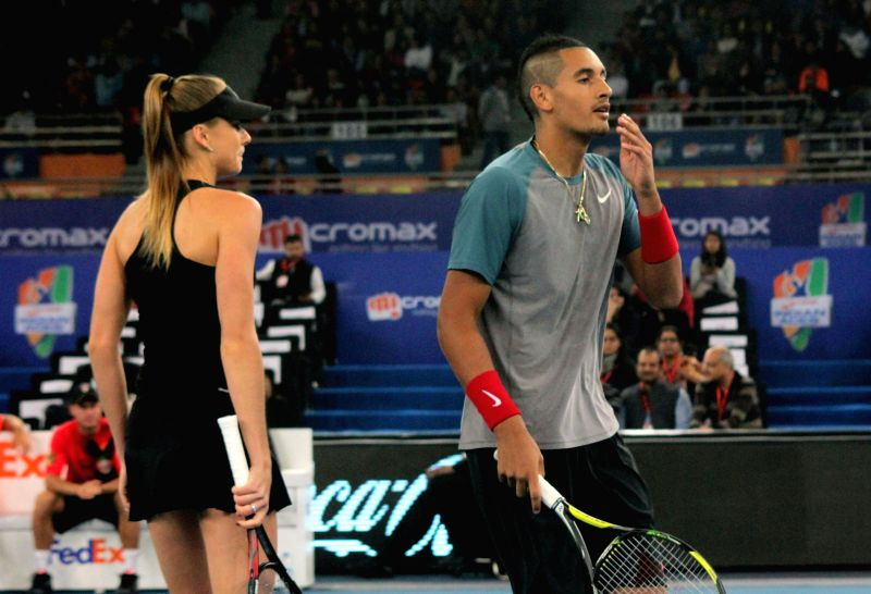 Singapore Slammers Nick Kyrgios and Daniela Hantuchova in action during their mixed doubles match against AE Royals Nenad Zimonjic and Kristina Mladenovic on the Coca-Cola International ...