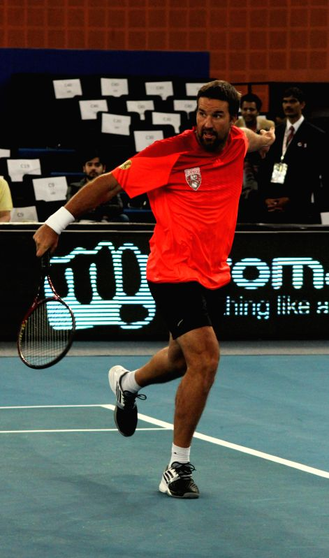 Singapore Slammers Patrick Rafter in action during his men's singles match against UAE Royals Goran Ivanisevic on the Coca-Cola International Premier Tennis League (IPTL) at IG Indoor ...