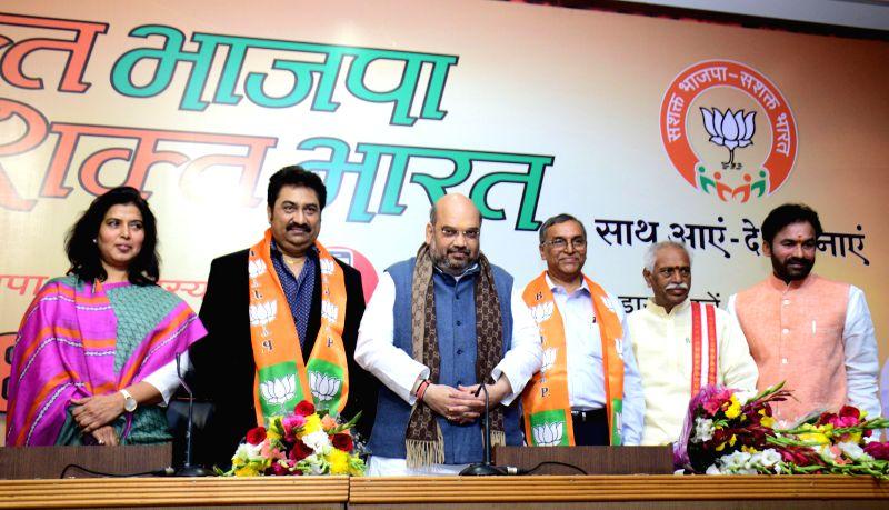 Singer Kumar Sanu and Andhra Pradesh Bar Council President Narashimha Reddy join BJP in presence of party chief Amit Shah in New Delhi, on Dec 2, 2014. Also seen Telangana BJP chief G. ... - Narashimha Reddy, Amit Shah and G. Kishan Reddy