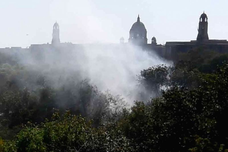 Smoke arising as a major fire breaks out at Parliament House complex in New Delhi on March 22, 2015.