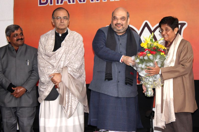Social activist and former IPS officer Kiran Bedi joins BJP in presence of (L-R) Delhi BJP Chief Satish Upadhyay, Union Minister for Finance, Corporate Affairs, and Information and ... - Satish Upadhyay, Arun Jaitley and Amit Shah