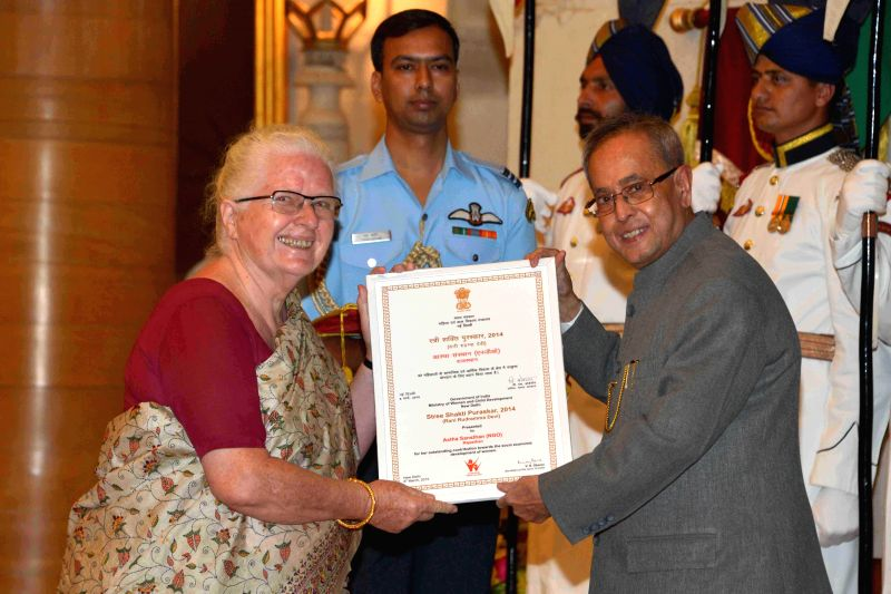 Social activist Ginny Shrivastava of Astha Sansthan (Rajasthan) receives the `Rani Rudramma Devi Award` from President Pranab Mukherjee at the presentation of Stree Shakti Puraskar 2014 on ... - Pranab Mukherjee