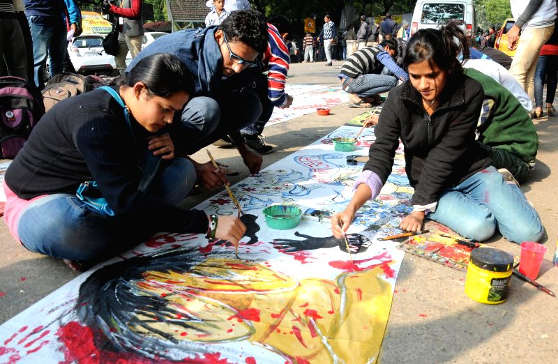 Social activists paint pictures to condemn 2012 Nirbhaya gangrape the  at Jantar Mantar in New Delhi on Dec 16, 2014.