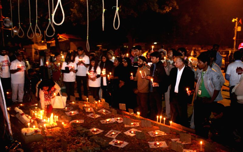 Social activists participate in a candlelight vigil to condemn the 2012 Nirbhaya gangrape in New Delhi, on Dec 16, 2014.