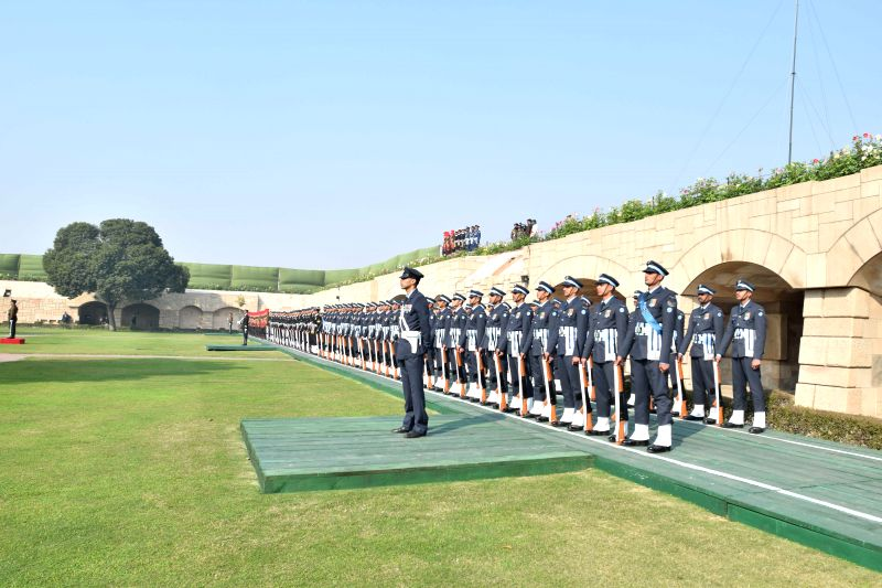 Soldiers paying homage at the samadhi of Mahatma Gandhi on the occasion of Martyr's Day, at Rajghat, in Delhi on Jan. 30, 2015.
