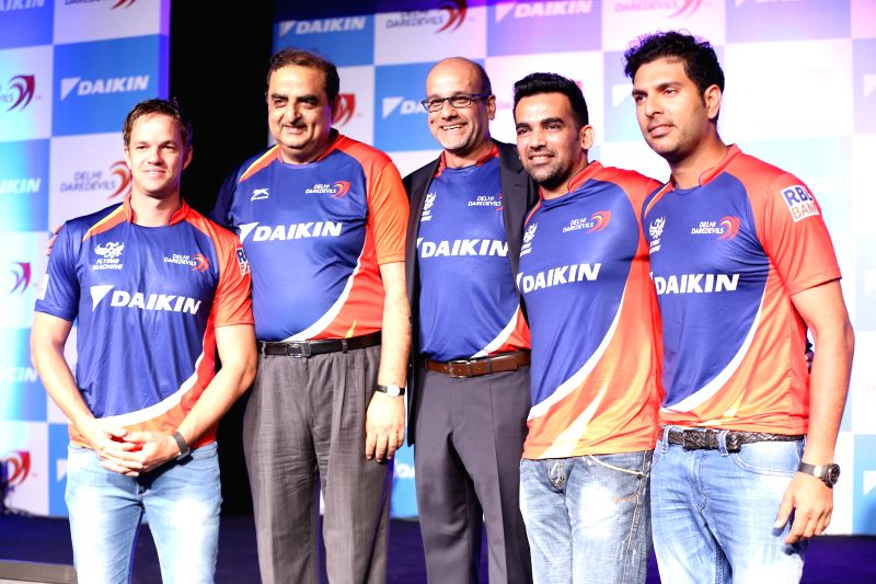 South African cricketer Albie Morkel, Managing Director of Daikin India Kanwal Jeet Jawa, and Indian cricketers Yuvraj Singh and Zaheer Khan during a programme organised to unveil the new ... - Yuvraj Singh and Zaheer Khan