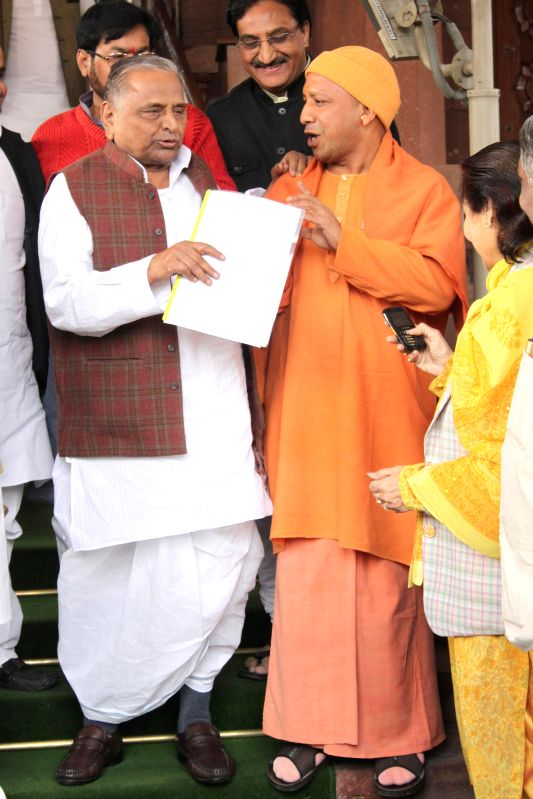 SP chief Mulayam Singh Yadav with BJP MP from Gorakhpur Yogi Adityanath at the Parliament premises in New Delhi, on Dec 18, 2014. - Mulayam Singh Yadav