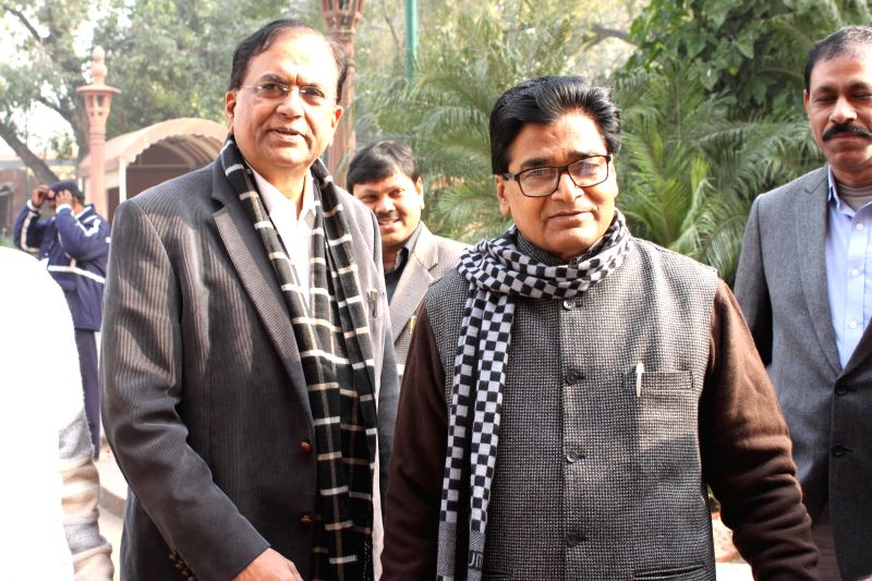 SP leader Ram Gopal Yadav with BSP leader Satish Mishra at the Parliament premises in New Delhi, on Dec 18, 2014. - Gopal Yadav and Satish Mishra