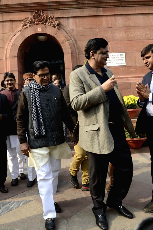 SP MP Ram Gopal Yadav and others at the Parliament premises in New Delhi, on Dec 18, 2014.