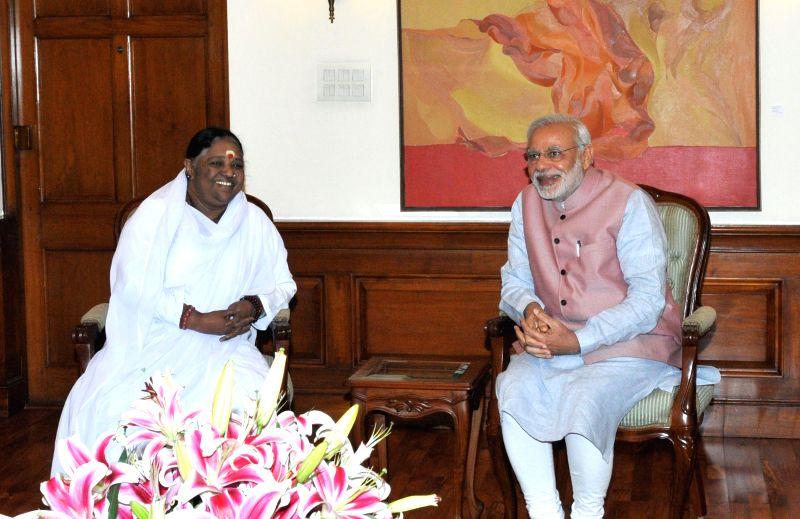 Spiritual leader Mata Amritanandamayi Devi calls on the Prime Minister Narendra Modi, in New Delhi on March 28, 2015. - Narendra Modi