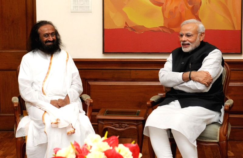 Spiritual leader Sri Sri Ravi Shankar calls on the Prime Minister Narendra Modi, in New Delhi on March 3, 2015. - Narendra Modi