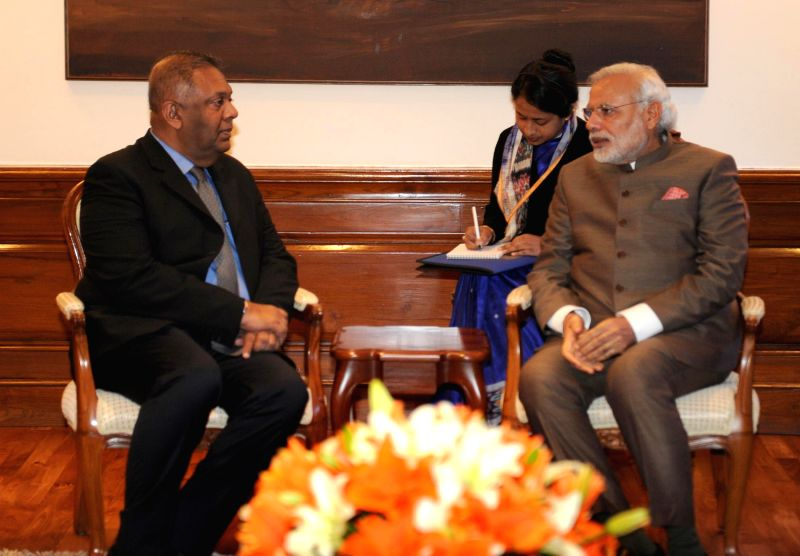 Sri Lankan Foreign Minister Mangala Samaraweera calls on Prime Minister Narendra Modi, in New Delhi on Jan 19, 2015. - Mangala Samaraweera and Narendra Modi