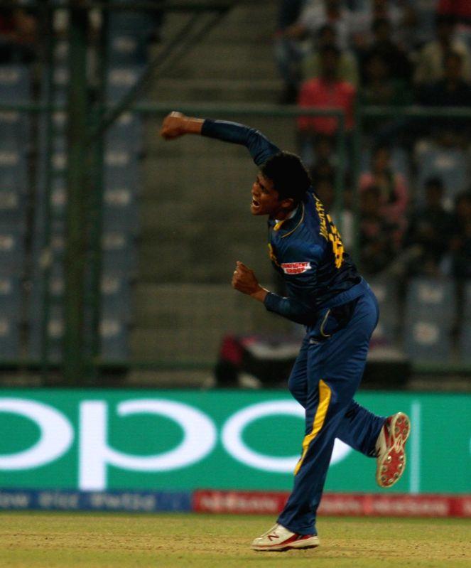 New Delhi: Sri Lankan player Jeffrey Vandersay celebrates fall of Jason Roy's wicket during a WT20 match between Sri Lanka and England at Feroz Shah Kotla stadium in New Delhi on March 26, 2016. (Photo: Surjeet Yadav/IANS)
