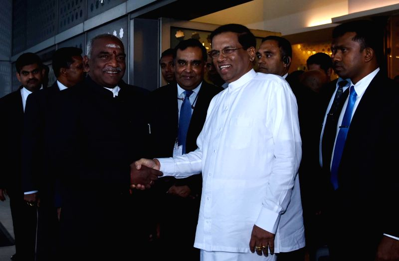 Sri Lankan President Maithripala Sirisena being received by the Union Minister of State for Road Transport and Highways and Shipping P. Radhakrishnan on his arrival, at Indira Gandhi ...