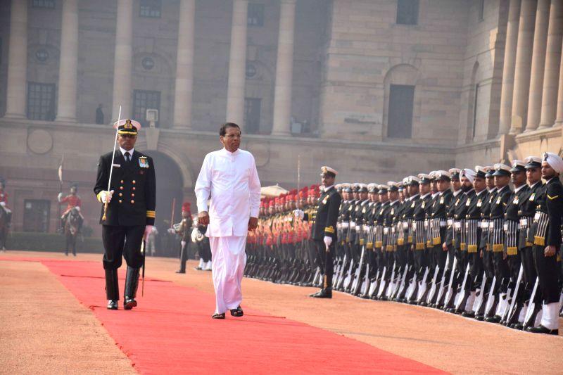 New Delhi : Sri Lankan President Maithripala Sirisena inspects Guard of Honour during his ceremonial reception at Rashtrapati Bhavan, New Delhi on Feb. 16, 2015.